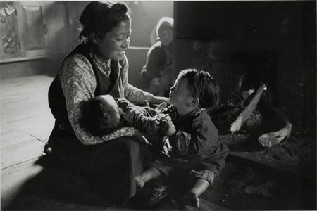 Family in Northern Sikkim relaxes by fireside