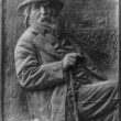 Walt Whitman, 1819-1892, half-length portrait, seated, facing right