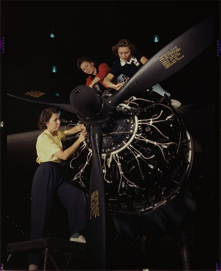 The careful hands of women are trained in precise aircraft engine installation duties at Douglas Aircraft Company, Long Beach, Calif.
