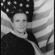 Portrait of Gertrude Stein, with American flag as backdrop