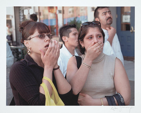Two women looking upwards with expressions of shock and horror, during the September 11th terrorist attack on the World Trade Center, New York City