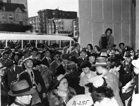 Lange photographing Japanese-American evacuees
