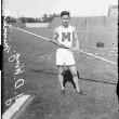 Y. D. Wong, of Minnesota, holding a pole used in pole vaulting, standing on the athletic field at Stagg Field Chicago(part of History Museum collection)