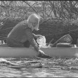 Girl Scout in canoe, picking trash out of the Potomac River during Earth Week 1970 April 22