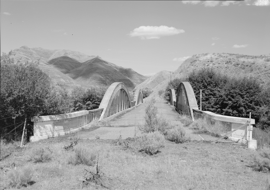 "Lowe, Jet. ""WESTERN PORTAL LOOKING NE BY 20 DEGREES - Indian Timothy Memorial Bridge, U.S. Route 12 spanning Alpowa Creek, Silcott, Asotin County, WA."" 1993. Library of Congress Prints and Photographs Division."