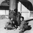 Children playing at the entrance to the temple, Nagoya, Japan