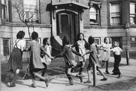"Children playing ""ring around a rosie"" in one of the better neighborhoods of the Black Belt, Chicago, Illinois"