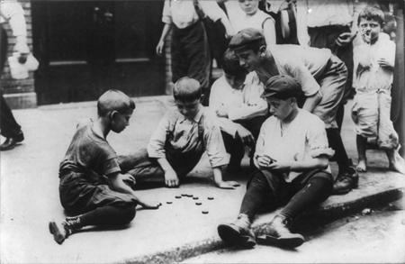 New York City - children on the street: boys playing checkers in the street