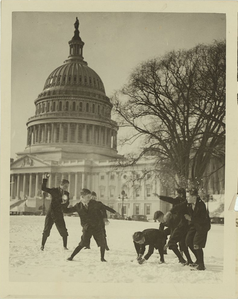 Senate page boys stage their first snow battle on the Capitol plaza