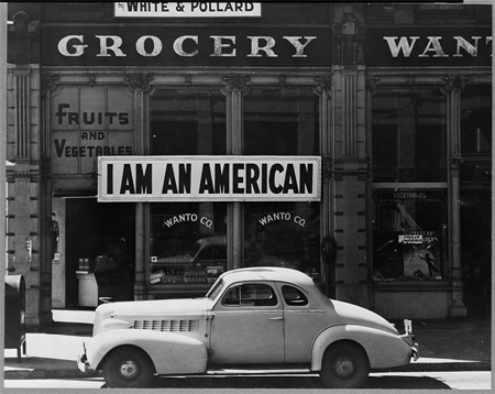 "A large sign reading ""I am an American"" placed in the window of a store on December 8, the day after Pearl Harbor."