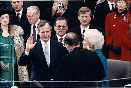 Chief Justice William Rehnquist administering the oath of office to George Bush