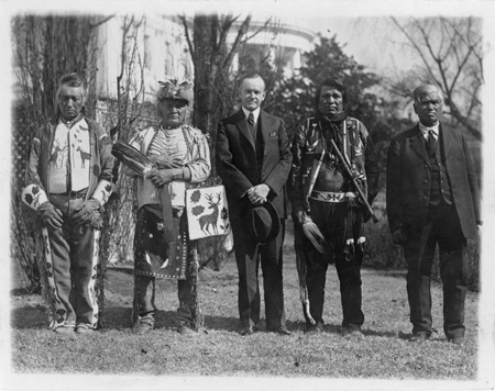 President Calvin Coolidge posed . . . with four Osage Indians