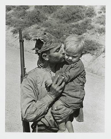 Soldier kisses his son goodbye, Spain.