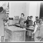 """Mrs. Claire Cumberbatch, of 1303 Dean St., leader of the Bedford-Stuyvesant group protesting alleged """"segregated"""" school, leads oath of allegiance"""