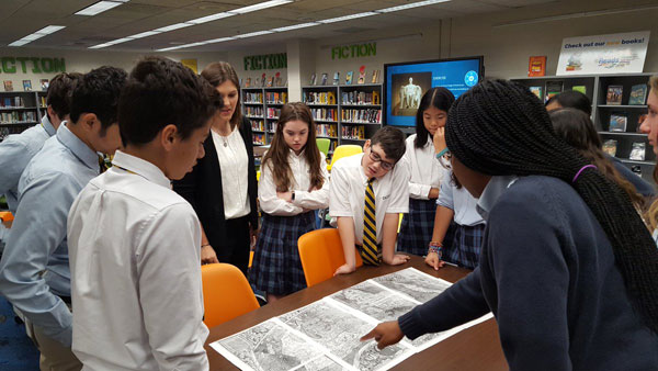 DCD School 8th graders collaborated in the library to analyze primary sources from a summer teacher institute that history teacher Victoria Marcone attended at Library of Congress