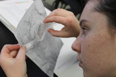 Student-analyzing-a-map